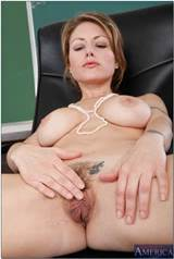 Blonde MILF teacher Velicity Von spreading her pussy on the desk.