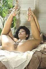 Vanessa Del Rio grabs her feet and lifts them in the air