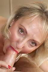 Slutty blonde milf babe reveals her juicy pussy posing on the bed in ...